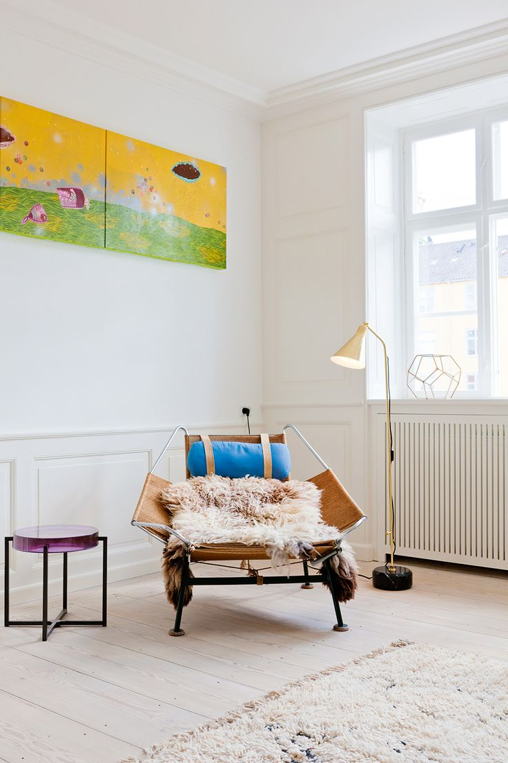 A light, airy, and artful space is accented with pops of bright color.