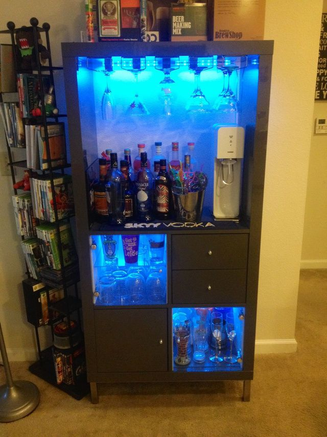 Turned ours (Expedit) into a bar/drink station using Ikea bathroom vanity legs and wine glass racks. The LEDs are from Ikea also and change colors.