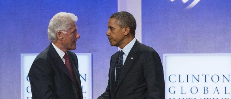 Former U.S. President Bill Clinton shakes hands with U.S. President Barack Obama after a discussion about healthcare at the Clinton Global Initiative (CGI) in New York September 24, 2013. REUTERS/Lucas Jackson