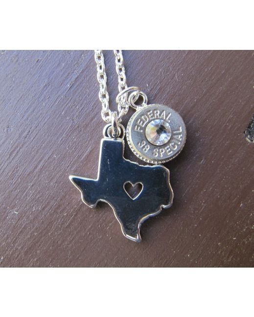 Show your love for Texas with this silver plated Texas charm with a heart cutout. Paired with a 38 caliber nickel plated bullet