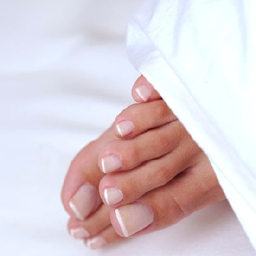 french pedicures or any color is a MUST.  If I see bad feet and toes, I literally gag.  Really I do.