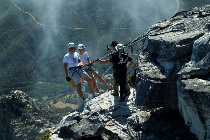 Abseilers at top of Table Mountain.