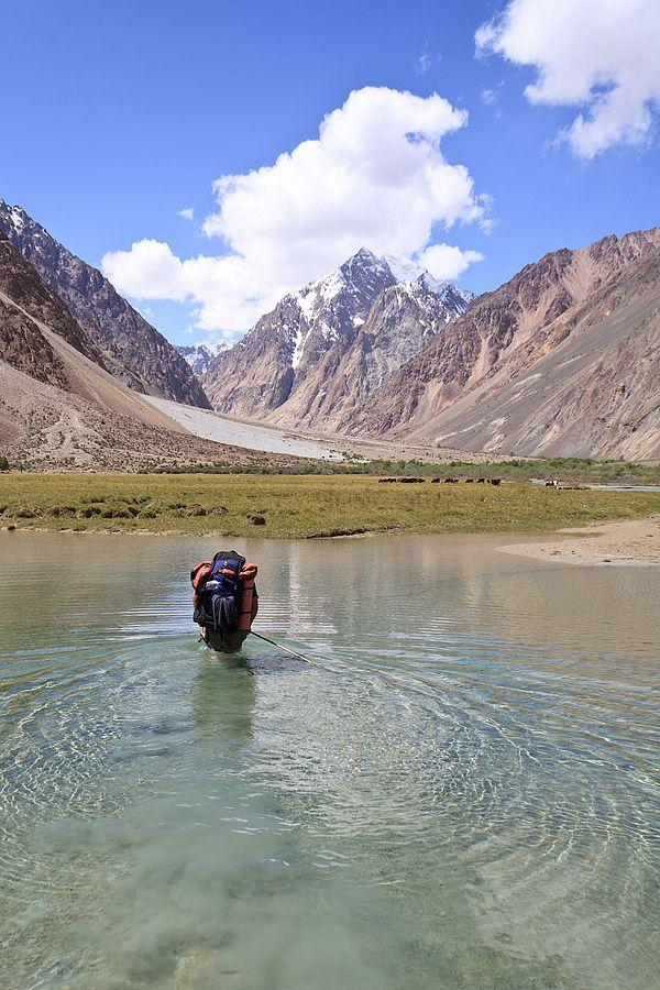 Crossing Sarez Lake on a Pamir Mountain trek.  Sarez Lake is in the Rushon District of Gorno-Badakhshan province, Tajikistan.