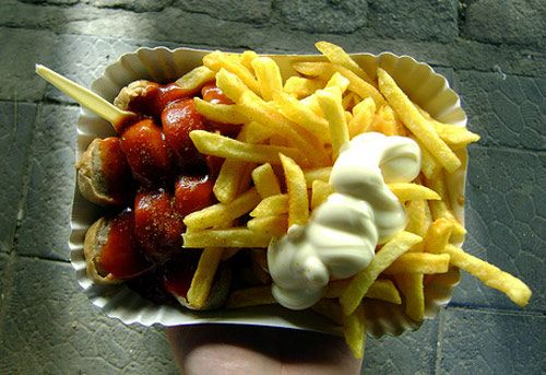 Currywurst in Berlin - The iconic snack of this great city and loved by everyone. A German style pork sausage usually bockwurst is deep fried, cut into pieces, and topped with a ketchup-like tomato sauce and curry powder, and usually served with french fries or a bread roll. This combination was invented in 1947 by Herta Heuer, who was influenced by American and British soldiers who loved ketchup and curry powder respectively. A must-try when in Berlin.