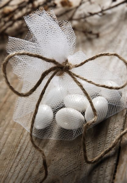 Adding some tradition to our wedding. In traditional Greek weddings, sugarcoated almonds are called koufetta. They are placed in little bags in odd numbers and are served on a silver tray. Because odd numbers are indivisible, this symbolizes that the newlyweds will share everything and remain undivided. Tradition holds that if an unmarried woman puts the almonds under her pillow, she'll dream of her future husband.