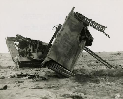 LVTs (landing vehicle tracked) knocked out by Japanese land mines and artillery fire; Iwo Jima - 1945