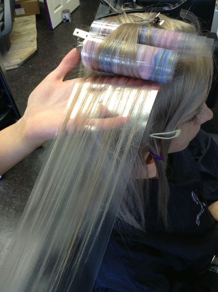 Pure tone being applied to pre-lightened hair using flamboyage at Samuel David Hairdressing