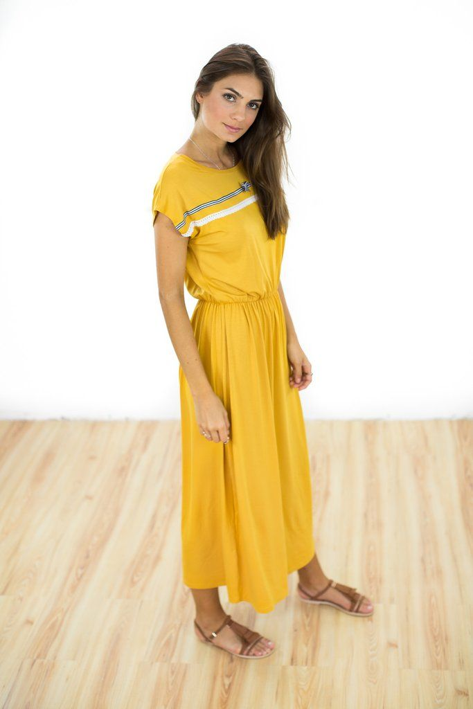 "Dress Curry in Mustard Yellow Effortless maxi dress crafted from a mustard yellow viscose fabric. The ""Curry"" dress has an elastic waistband and cute ribbon and bow detail along the chest. Easy to wear and super comfortable for the summer.  http://shoko-shop.com/collections/new-in/products/dress-curry-in-mustard-yellow"