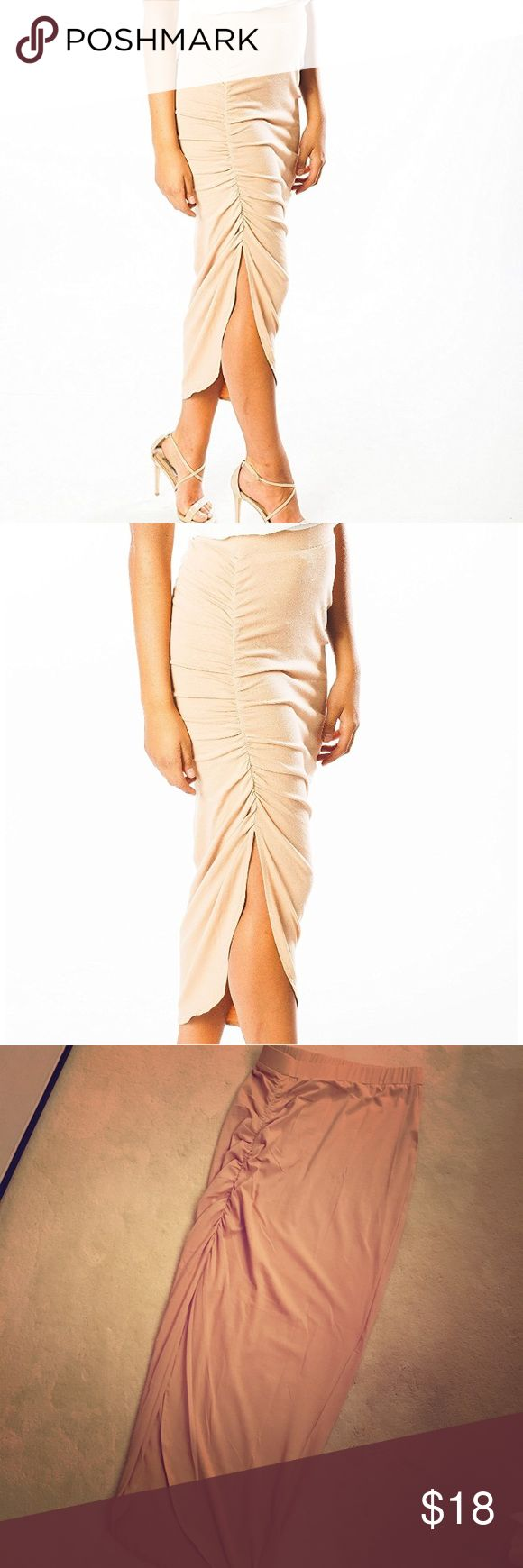 ARIANA JAMES Skirt Asymmetrical HIGH Waisted Skirt in Cotton/Lycra comfy jersey blend. It is beige colored, stretchy, very figure flattering and great to dress up or down. The side slit is sexy without revealing too much. This is a winner!! Size MEDIUM (#12-5) Ariana James Skirts Midi