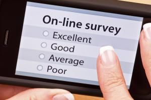 On-line survey with mobile phone - JillKyle/E+/Getty Images