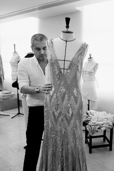 Elie Saab putting the finishing touches on one of his creations