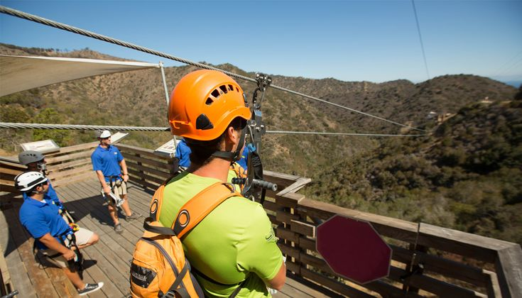 Catalina Island Zip Line Eco Tour, travel 3/4 quarters of a mile over 5 lines at heights of 300 ft above the canyon floor at speeds up to 45mph.