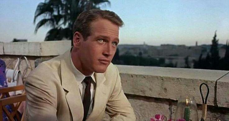 Wheat brown blazer, clean tie, with a short collar.  - Paul Newman
