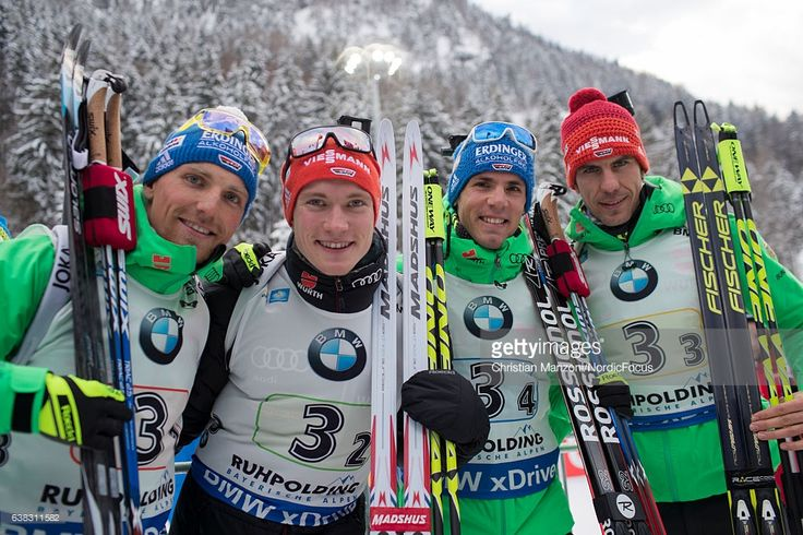 Erik Lesser, Benedikt Doll, Simon Schempp and Arnd Peiffer of Germany celebrate after the 4x7.5 km men's Relay on January 11, 2017 in Ruhpolding, Germany.