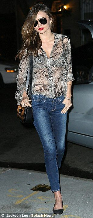 Casually chic: Even on a casual errand, Miranda managed to look glamorous with bright red lipstick and movie-star shades
