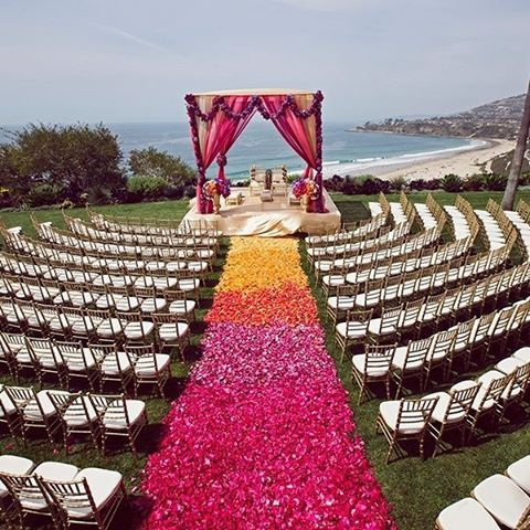 Obsessed with today's featured wedding that flipped the traditional use of color on its head by using a medley of pinks, purples and orange. Beautifully captured by @dukeimages. Venue: @ritzcarlton in Laguna Niguel