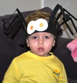Yo kid, you got a giant spider on your head. This is a very easy kids Halloween craft.