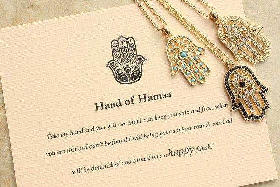A choice of 3 coloured Hamsa Hand necklaces each with a quote card. Choose between white, black or blue rhinestone studded Hamsa Hands. Each