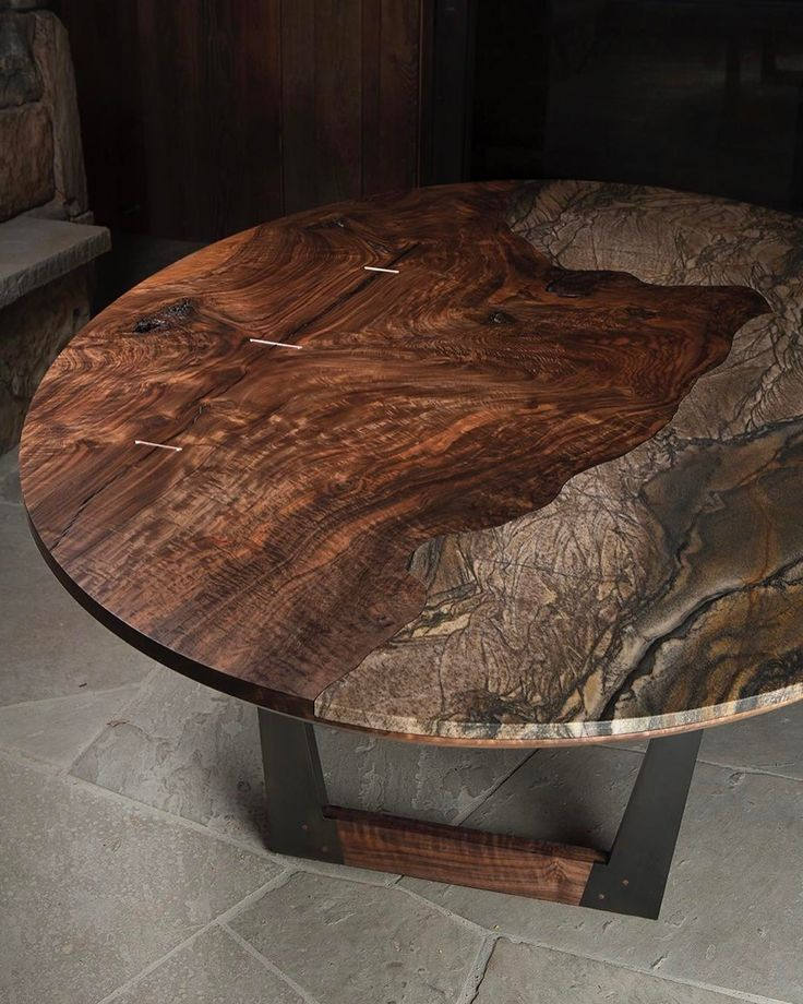 Paleolithic Pangaea Table in granite and Bastogne Walnut with copper Corsets and a blackened steel and Bastogne Walnut base. Before my drunken client got his hands on it