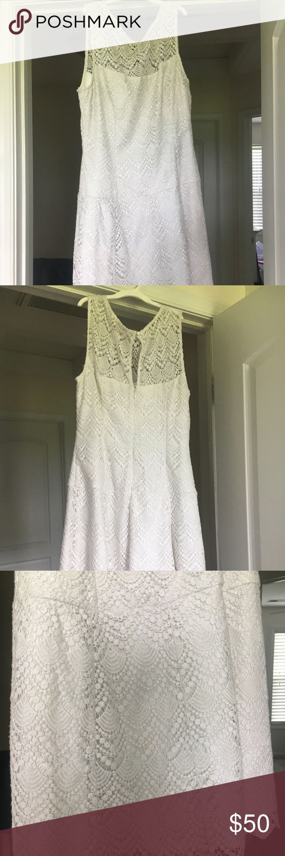 Beautiful Detailed White Lace Dress. Size 10. WHBM White House Black Market Dress. Size 10. Worn ONCE to my Rehearsal Dinner. Slight makeup stains around the collar, this may come out with a dry cleaning. Great condition. Beautiful lace details. Thick slip underneath so it isn't shear/see through. White House Black Market Dresses Wedding