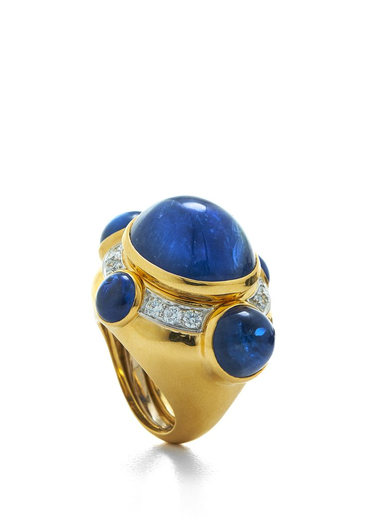 David Webb Ring Comprised of Oval and Round Cabochon Sapphires, Polished 18K Gold, and Platinum