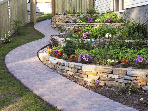 Some elements, like stone paving and rock walls, anchor the space, while others, such as trees, shrubs and flowers, are fleeting and change throughout the seasons.