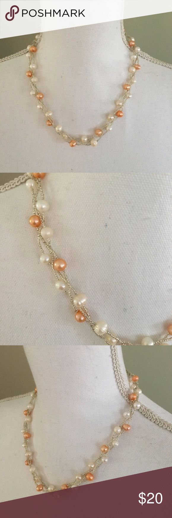 """Pink and White Freshwater Pearls These pink/peach and white freshwater pearled are intertwined with clear beads. Clasp closure. Length: 19.5"""". Jewelry Necklaces"""