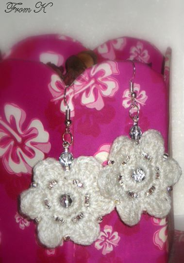 Beaded Crochet Dangle Earrings. For an elegant look. Light and strong. They are crocheted with pure white acrylic yarn and embroidered with Czech shiny clear seed beads. It is one of a kind piece and a beautiful addition to your jewelry collection. About 4 cm in diameter, and 5 cm long with the ear piece. 15.00 Ron