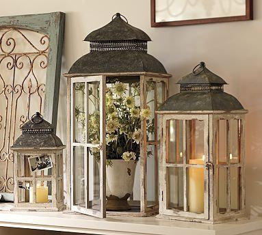 Love lanterns and bird cages. For the bay windows? Love the old frame to the left in this pic too.