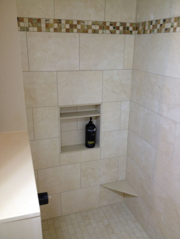 Shower With Accent Border, Niche, And Foot Rest For Shaving.