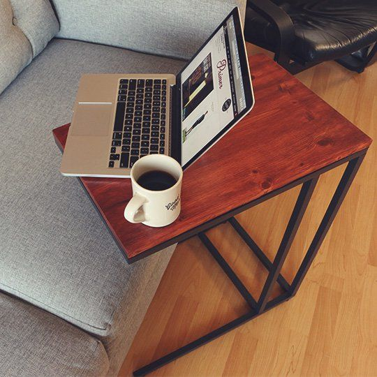 This gorgeous rustic laptop table was made from the IKEA Vittsjo table, which comes with a plain glass top… but this one was customized using a wooden plank to cover the top surface