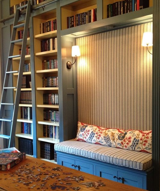 built-in bookshelves, library ladder, window seat, sconces, blue (via The Designer's Attic: Quadrille)