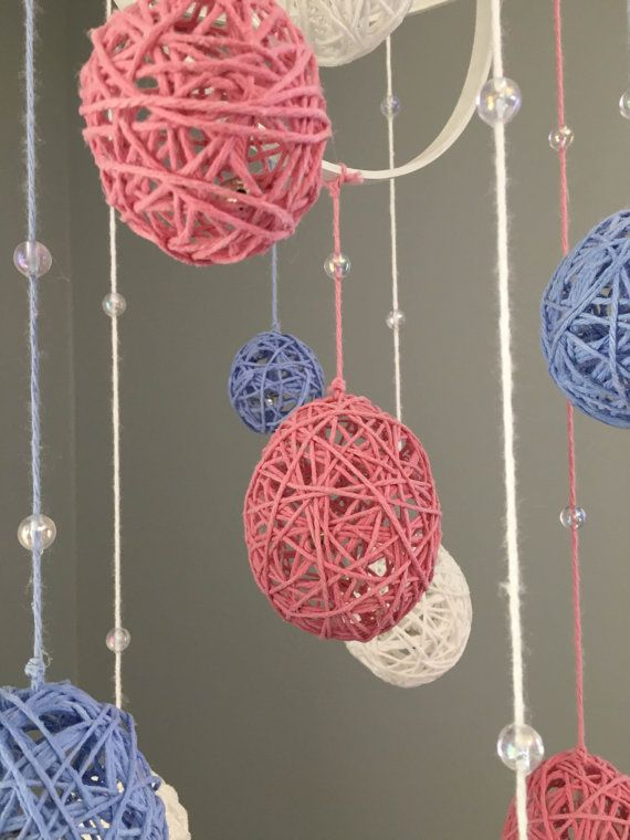 Decorative Baby Floating Yarn Ball Mobile by OneWildPreciousLife, white, pink and blue baby nursery decorations