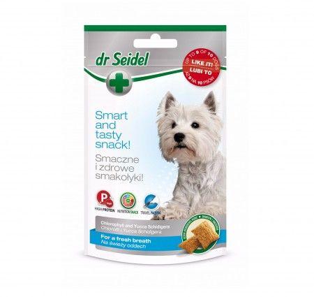 dr Seidel Smakołyki dla psów na świeży oddech. Smakołyki dla psów odświeżające oddech i neutralizujące nieprzyjemne zapachy. Wzbogacone o chlorofil i Yucca Schidigera. Chlorofil ma właściwości dezodorujące, dzięki czemu neutralizuje nieprzyjemny zapach z pyska. Yucca Schidigera hamuje rozwój bakterii rozkładających mocznik, przez co zmniejsza intensywność zapachu zwierząt, a także ich odchodów. Produkt dostępny w poręcznym opakowaniu ze strunowym zamknięciem.