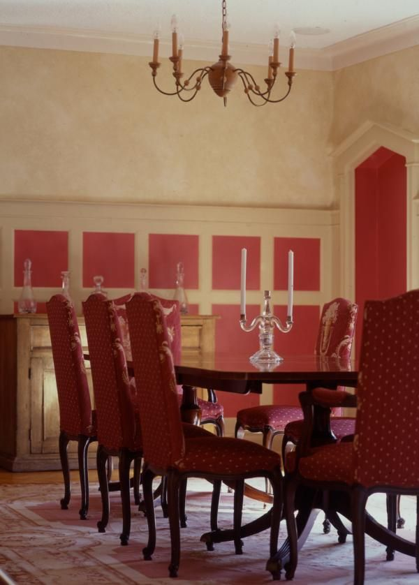 Pink Paneled Walls - Vibrant pink paneling adds like to this traditional dining room.