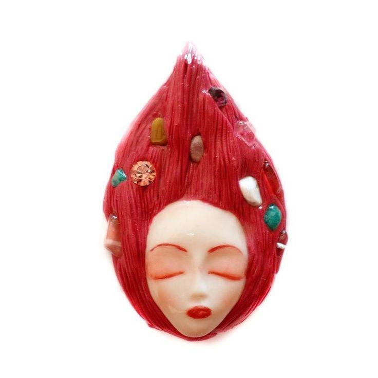 She has amazonite crystals lime jade howlitclear quartz and cherry quartz in her hair.  #instajewelry #jewelrygram #jewelrydesign #jewelrydesigner #jewelryaddict #customjewelry #fashionjewelry #loveit #artist #artisan #jewelry #etsyjewelry #handmadejewelry #red #jewelryforsale s #etsyshop #clayjewelry #artisanjewelry #handmade #crystals #semipreciousstones #semiprecious #redjewelry#pagan #crystaljewelry #crafter #art #artjewelry #goddess #wiccan