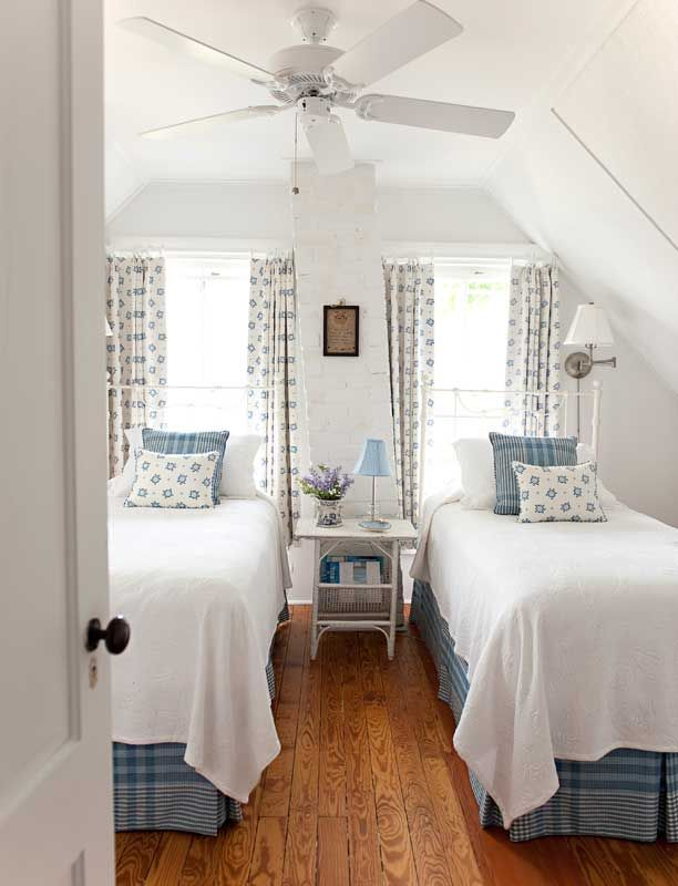 Cotton and linen complement cottage furniture in rooms furnished with lighthearted antiques and paintings with seashore motifs.Photo: Edward Addeo