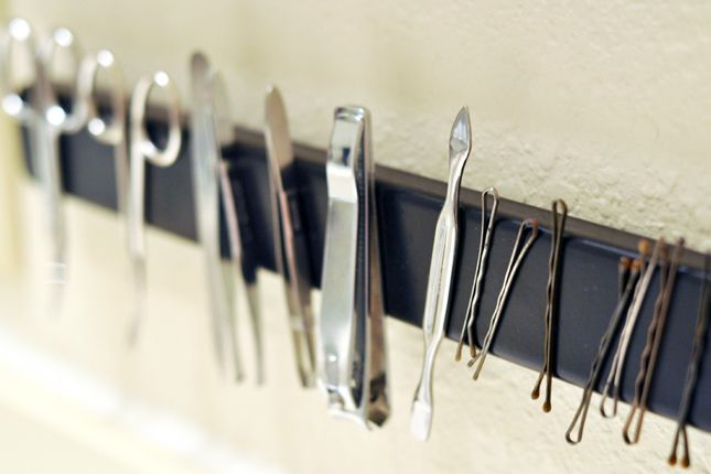 40 Brilliant DIY Organization Ideas ~ Magnetic Bathroom Rack: No more wasted time digging for tweezers and nail scissors.