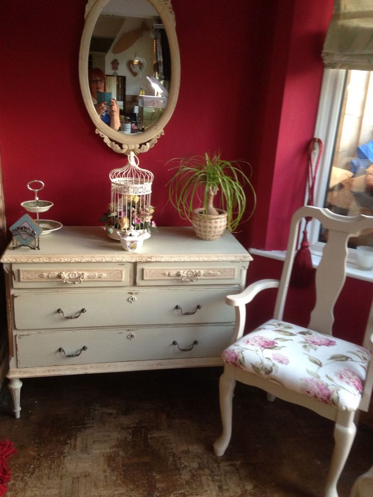 Chest of drawers painted in old ochre and wolf chair in old ochre and Laura Ashley fabric