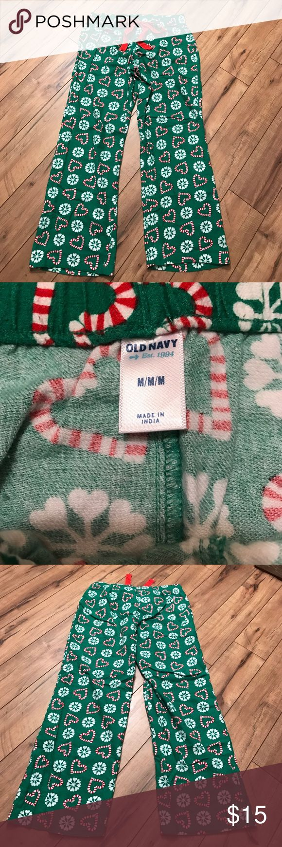 Old Navy Christmas pajama pants EUC. Old Navy Christmas pajama pants with candy cane hearts and snowflakes. Red ribbon tie. Very soft flannel-like feel. Warm and cozy. No defects. From non-smoking home. Size medium Old Navy Intimates & Sleepwear Pajamas