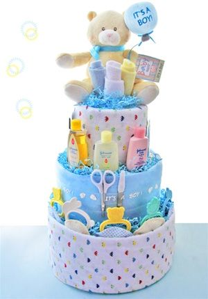 """What exactly is this thing called a diaper cake that everyone's been talking about? It's actually a very cute idea for a baby shower centerpiece or gift for the expectant mom at her baby shower. It's a tiered """"cake"""" made entirely out of rolled diapers. You can add as many tiers as you like to make it the center of attention or as few as you like to make it a simple gift. It's great to bring to the hospital when you first meet the new baby or to give whenever a new baby is born. Here's how to…"""