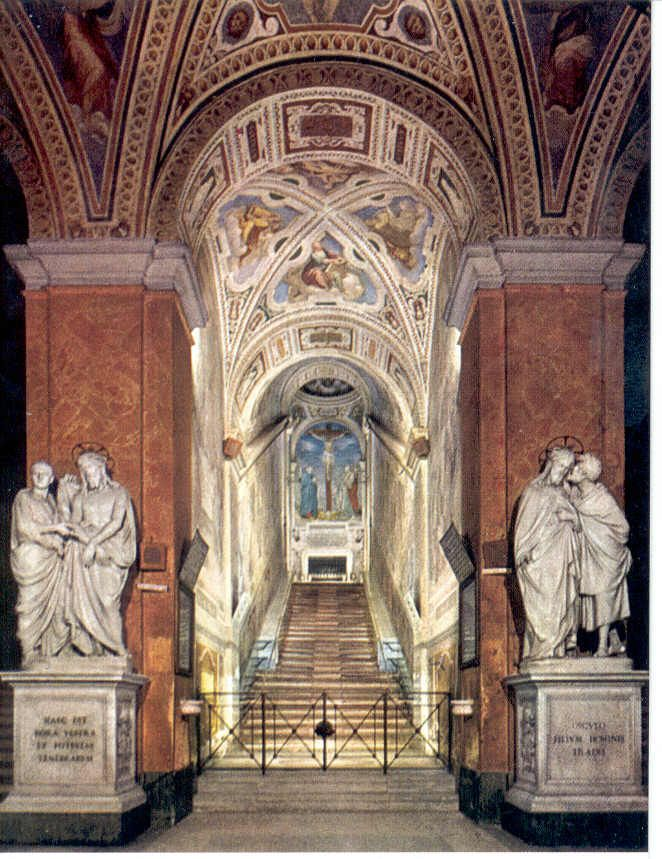 La Scala Santa (The Holy Stairs) in Rome, Italy.    The 28 marble steps are said to be those that Christ ascended in Pontius Pilate's palace during His trial.  They were brought to Rome by St. Helena, Constantine's mother.  No foot can touch the Holy Stairs so they are covered with wooden boards for protection.  I crawled up those on my knees a few years ago. Didn't think I was going to make it.