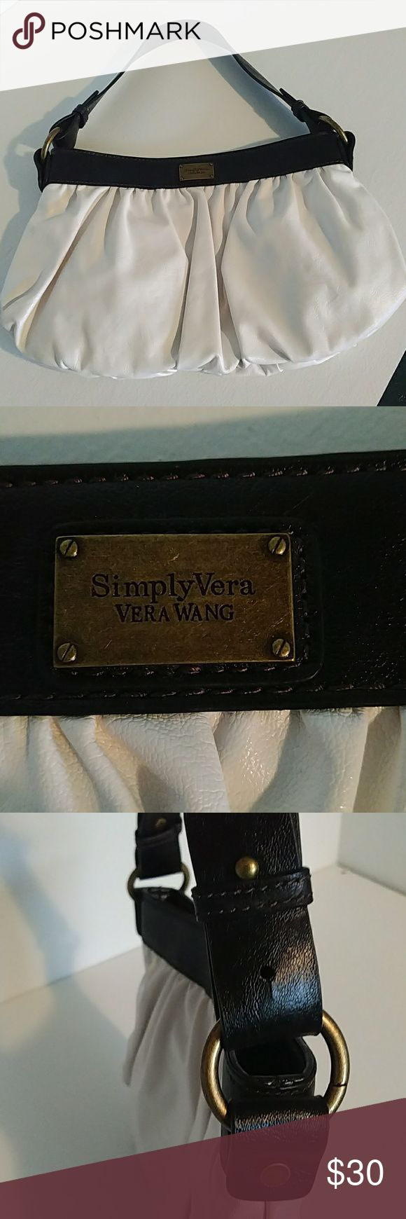 Simply Vera Vera Wang.  Beautiful purse!! Simply Vera Vera Wang.  Beautiful purse!! White with black trim and strap. This purse is very nice! I used it once for about 3 hours . Fits everything a gal could need. Simply Vera Vera Wang Bags Hobos
