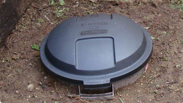 Dog compost bin (not to be used on edible garden): 1. Cut off bottom of bin and drill holes in its walls.  2. Bury to rest about 3in above the soil. 3. Add rocks/gravel to help with drainage. 4. Begin filling with dog poop and secure the lid. 5. After a few days, add septic starter enzyme (find at hardware store) to help with decomposing. Add more every 6 months or so. You can use the resulting compost on flower beds or allow it to remain and slowly seep into the soil.