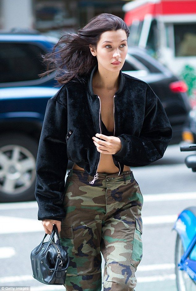 Top of the crops: It was not hard to see why the 20-year-old had made the cut with Bella showing off her perfect for lingerie-abs in a pair of loose-fit camo pants which she wore with just a bralette and a cropped jacket