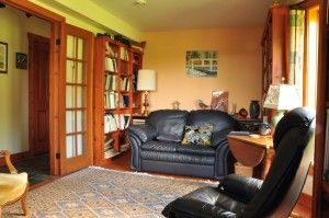 Hill House - the library.  Bow windows, floor to ceiling built in book cases, small paned French doors.  House and land for sale www.nspropertysale.com