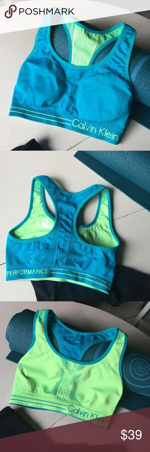 Calvin Klein Aqua + Lime Reversible Sports Bra Add some energy to your workout wardrobe with this bright Aqua + lime Reversible Sports Bra from Calvin Klein Performance. Very breathable fabric, plenty of stretch but holds its shapes and gives good support for high impact exercise. Tags removed. Excellent condition. Size Medium. Calvin Klein Intimates & Sleepwear Bras