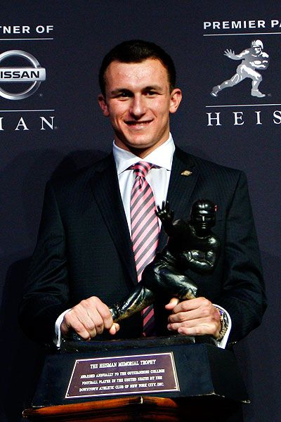 Texas A quarterback Johnny Manziel became the first freshman to win the Heisman Trophy, taking college football's top individual prize Saturday night after a record-breaking debut.  December 2012