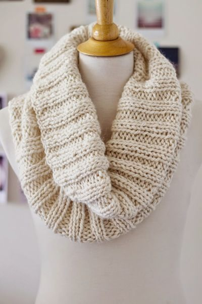 Drive away the winter blues with the Cozy Ribbed Cowl. This knit scarf pattern consists of a simple 2x2 rib stitch for a beautiful knitted accessory you'll love reaching for again and again. If you don't already know how to knit a scarf, this knitting pattern is a great place to start.