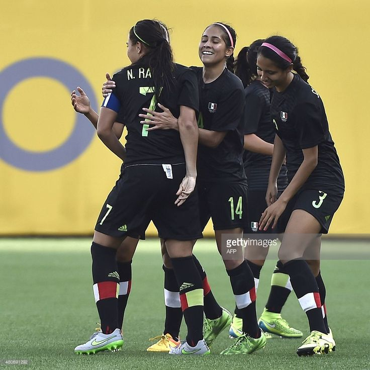 July 14 - Football - Women - First Round. Mexico vs Argentina.  Nayeli Rangel (L) of Mexico celebrates with teammates the second goal against Argentina during their women's group A first round football match for the Pan American Games in Hamilton, Canada, on July 14, 2015. AFP PHOTO / OMAR TORRES